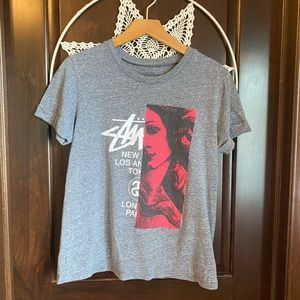 {Stussy} worn in graphic tee